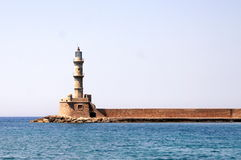 Lighthouse at the entrance to the harbour. Royalty Free Stock Photography