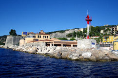 Lighthouse at the entrance to harbour Villefranche Sur Meer at french riviera Royalty Free Stock Photography