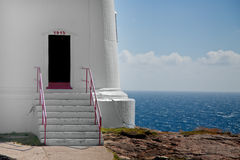 Lighthouse entrancewith red Royalty Free Stock Photos