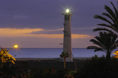 Lighthouse in evening stock images