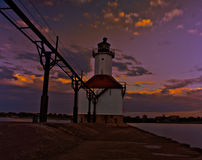 Lighthouse in the evening. With golden clouds Stock Photography
