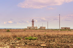 Lighthouse in field Stock Image