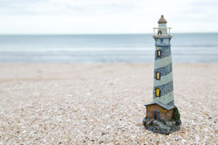 Lighthouse figure on the beach in the evening Stock Image