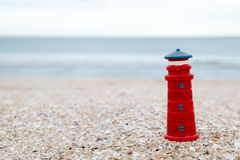 lighthouse figure on the beach in the evening Stock Photos