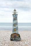 Lighthouse figure on the beach in the evening Royalty Free Stock Photos