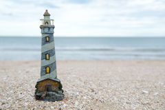 Lighthouse figure on the beach in the evening Stock Photography
