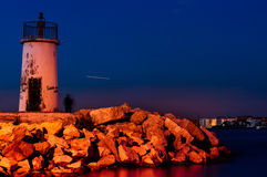 Lighthouse And Fishermen Royalty Free Stock Image