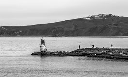 Lighthouse and fishermen royalty free stock photos