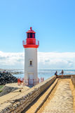 Lighthouse in fishing port La cotiniere, France. La cotiniere, France 4 august 2015: Lighthouse in fishing port on Oleron island, Charente Maritime, France royalty free stock photos