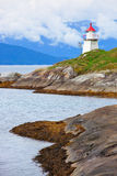 Lighthouse on fjord coast Stock Image