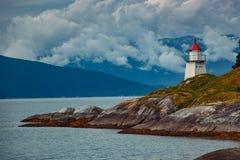 Lighthouse on fjord coast Stock Photo