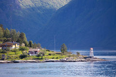 Lighthouse on a fjord shore Stock Image