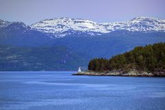 Lighthouse on a fjord shore. Norway Royalty Free Stock Photos