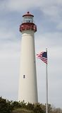 Lighthouse with flag. Lighthouse with American flag, Cape May, New Jersey, USA Royalty Free Stock Photography