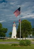 Lighthouse and Flagpole Stock Photo
