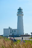 Lighthouse at Flamborough Head. Near Bridlington,  in East Yorkshire, north of England with tourists looking out to the North Sea Royalty Free Stock Photography