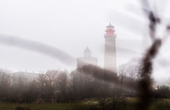 Lighthouse in fog mist and clouds Royalty Free Stock Image
