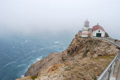 Lighthouse in the Fog Stock Image