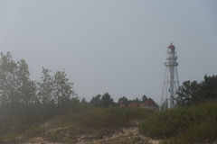 Lighthouse in Fog Royalty Free Stock Photography