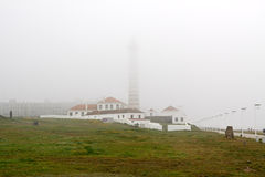 Lighthouse on a foggy morning Stock Images