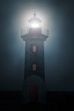 Lighthouse in a foggy night. River mouth lighthouse and granite pier in a foggy night stock images