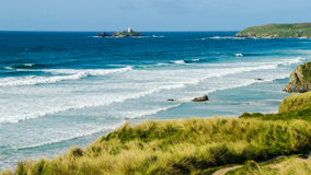 Lighthouse and foreshore at Godrevy Point Stock Photos