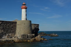 Lighthouse of the fort of Brescou. Near the Cape d`Agde in France, enthroned on its tower with the méditerranean sea and blue sky Stock Images