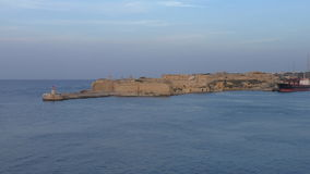 Lighthouse and Fort Ricasoli,Valletta city port stock video footage