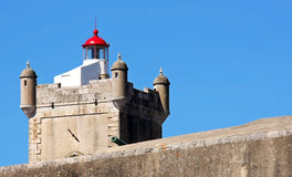 Lighthouse fortress of St. Julian's bar. Lighthouse of the fortress of St. Julian of Barra at the mouth of the river Tagus Royalty Free Stock Image