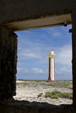 Lighthouse framed in doorway. A view looking through a doorway toward the lighthouse on the southern tip of the island of Bonaire in the Netherlands Antilles Royalty Free Stock Photography