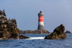 Lighthouse in full sea Royalty Free Stock Image