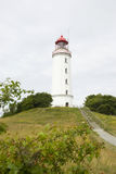 Lighthouse on german island Hiddensee. White tower and lighthouse on german island Hiddensee royalty free stock photography