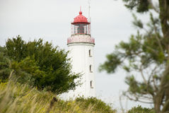 Lighthouse on german island Hiddensee. White tower and lighthouse on german island Hiddensee royalty free stock photos