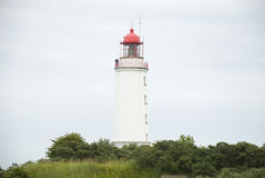 Lighthouse on german island Hiddensee. White tower and lighthouse on german island Hiddensee royalty free stock photo