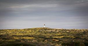 Lighthouse Gnaraloo Station Australia Coast shrub hill Royalty Free Stock Photos