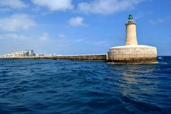Lighthouse in Grand harbor, Malta Stock Image