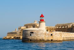 Lighthouse in Grand Harbour. (Valletta, Malta Royalty Free Stock Photography