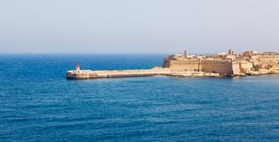 Lighthouse in Grand Harbour. (Valletta, Malta Stock Photos