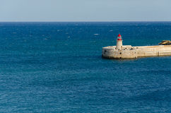 Lighthouse in Grand Harbour, Valletta, Malta Royalty Free Stock Photography