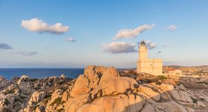 Lighthouse on granite rock formations at Capo Testa, Sardinia, Italy. Stock Images