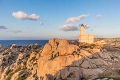 Lighthouse on granite rock formations at Capo Testa, Sardinia, Italy. Royalty Free Stock Photos