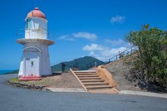 Lighthouse on Grassy Hill, Cooktown with steps to lookout. View of the lighthouse on Grassy Hill, Cooktown with Mount Cook in the background and steps leading Royalty Free Stock Images