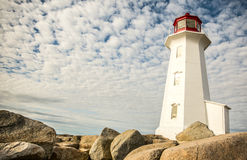 Lighthouse with great clouds formation Stock Photo