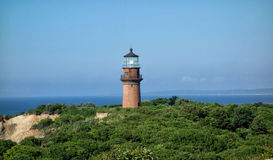 Lighthouse. On the green cliff royalty free stock photos
