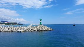 Lighthouse. Green lighthouse on the sea Stock Images
