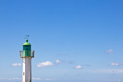 Lighthouse green top. The upper part of a green lighthouse on a sunny day Stock Photography