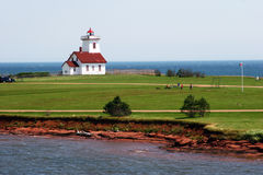 Lighthouse Greens. A classic lighthouse, set amid a luscious green lawn, protects the tip of Prince Edward Island, Nova Scotia, Canada Stock Images