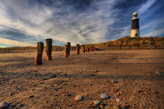 Lighthouse & Groynes at Spurn Point Stock Photography