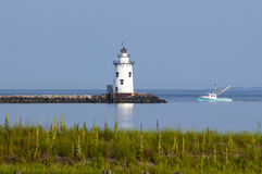 Lighthouse Guides Fishing Boat Home Stock Photo