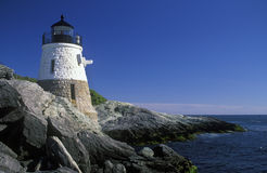 Lighthouse Guides Mariners Around Rocky Shoreline Royalty Free Stock Photography